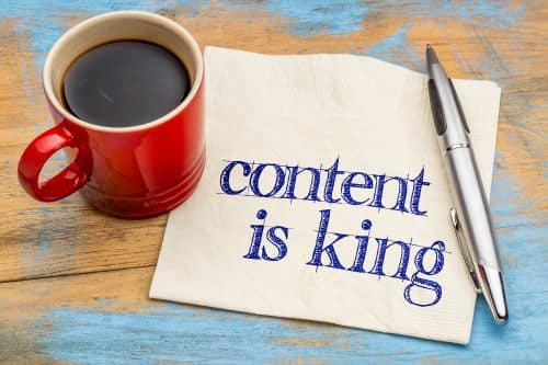 content is king coffee cup pen paper